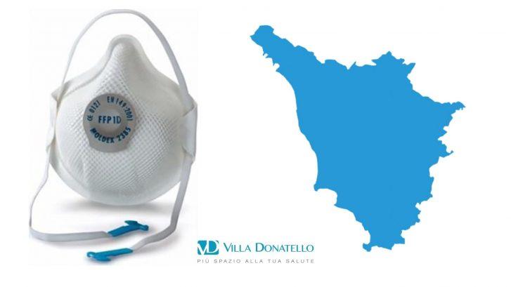 una mascherina chirurgica ffp1 accanto alla mappa della regione toscana