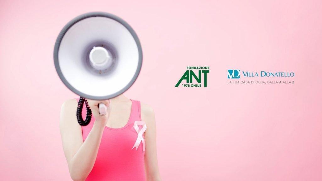 Una donna con fiocco rosa per la prevenzione, urla in un megafono